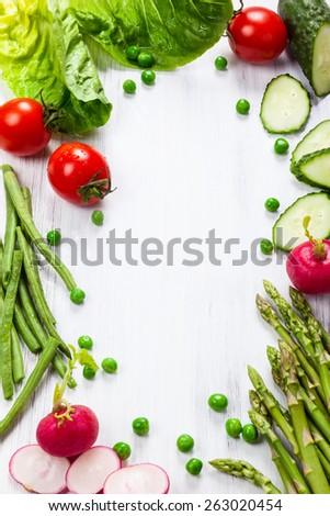 Fresh vegetables on the white wooden table - Shutterstock ID 263020454