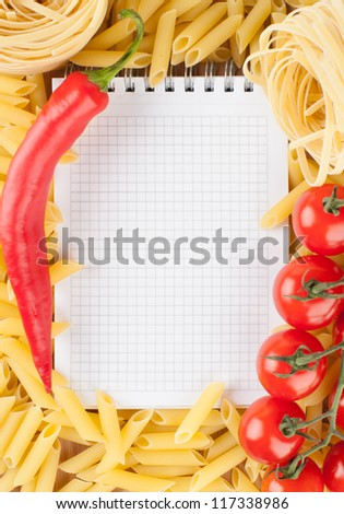 Fresh vegetables, pasta and notebook
