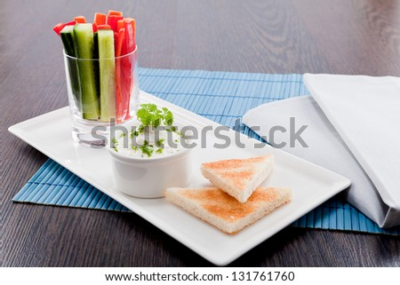 fresh vegetables snack and cream cheese dip with bread on plate