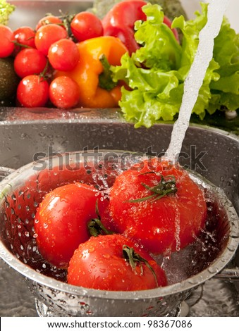Fresh vegetables splashing in water before cooking