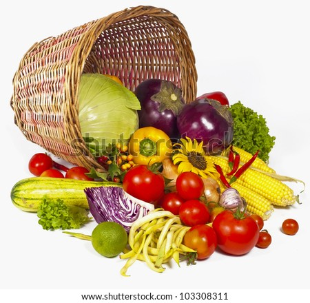 fresh vegetables with green leaves in the basket isolated on white background