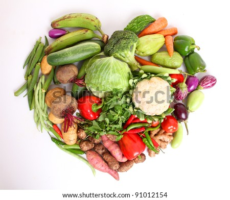 fresh vegetables with heartin shape on white background.