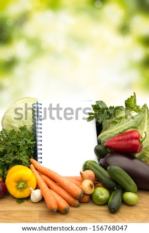 Fresh vegetables with notes on wooden table on green background  #156768047