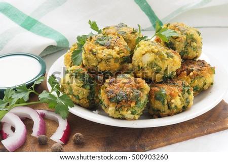 fresh vegetarian falafel balls on a palte with sauce #500903260