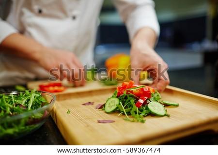 Fresh vegetarian salad on wooden board