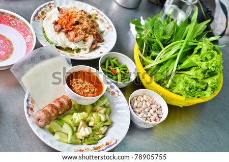 Fresh Vietnamese style food set , Grilled pork with vegetables and wrapping flour - stock photo