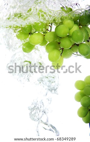 Fresh vine grape dropped into water