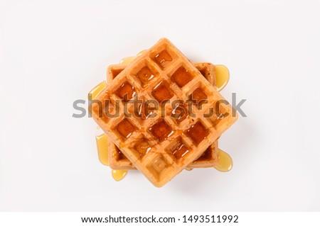 Fresh waffles with honey isolated on white background.Top view Stock fotó ©