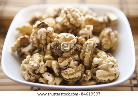 fresh walnuts on the white plate