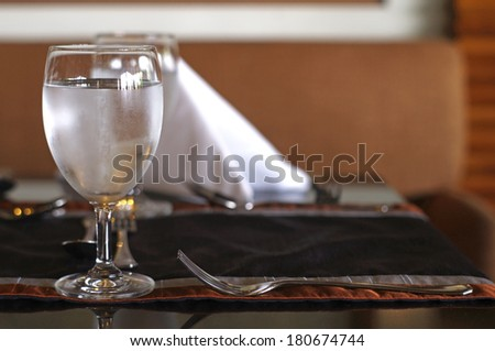 fresh water in the grass on the dining table