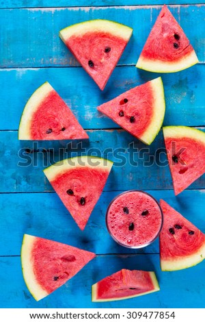 Fresh water melon drink  and water melon slice on Blue wood.Top view - Shutterstock ID 309477854