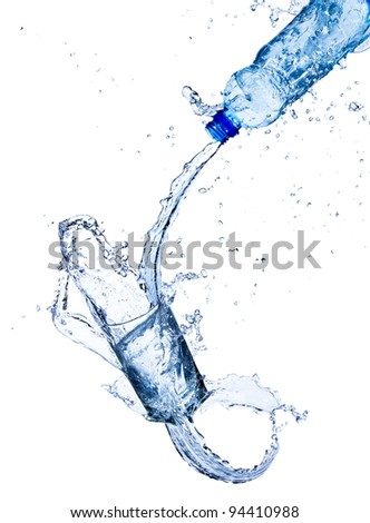 Fresh water pouring into glass, isolated on white background