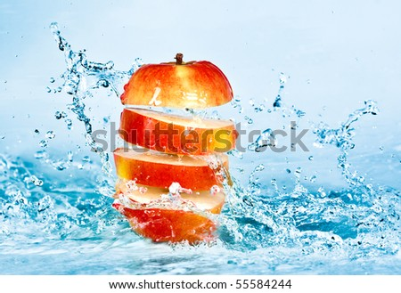 fresh water splash on red apple