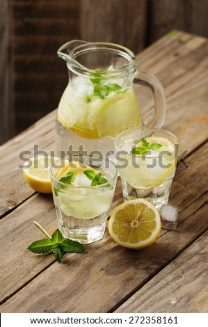 Fresh water with lemon, mint and cucumber, selective focus