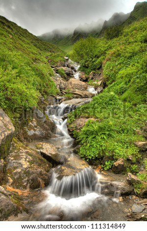 Fresh Waterfall from Mountain Spring, Alps