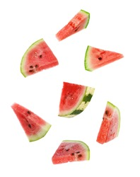 Fresh watermelon pieces falling on white background