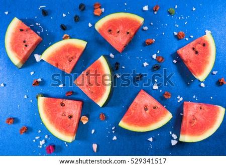 Fresh watermelon slice on blue background  - Shutterstock ID 529341517