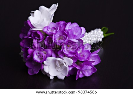 Fresh wedding  bouquet from fresia flowers on dark background