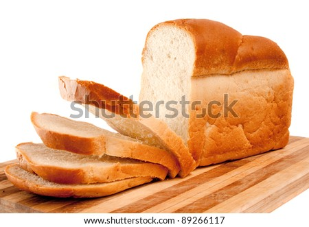 fresh wheat sliced bread on kichen board over white