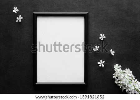 Fresh white bird cherry on black, dark background. Condolence card. Empty place for emotional, sentimental text, quote, sayings or photo in frame. #1391821652