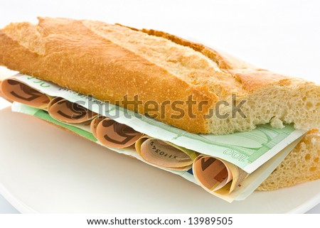 Fresh white loaf with a layer of monetary denominations inside