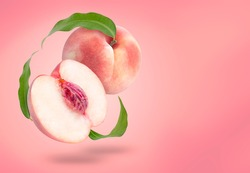 Fresh White Peach fruit with leaf isolated on Peach colour background With clipping path,