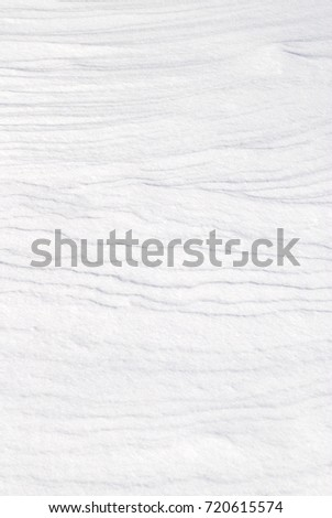 Fresh white snow background texture showing contours and layers. #720615574