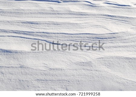 Fresh white snow background texture showing contours and layers. #721999258