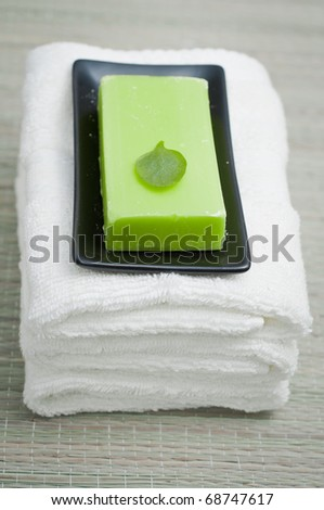 Fresh white towels, soap and candle