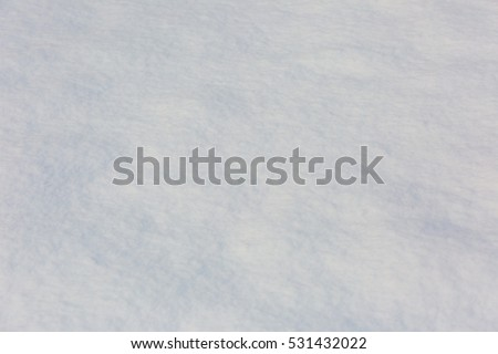 Fresh white winter snow. Abstract background of natural snow. #531432022