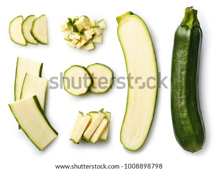 Fresh whole and sliced zucchini isolated on white background. From top view