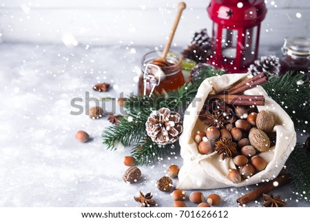 Fresh whole nuts and spices spilling
