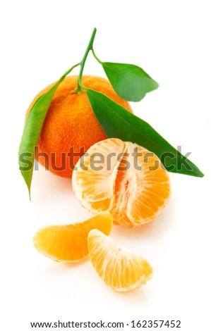 Fresh whole tangerine and slices isolated on white background. - stock photo