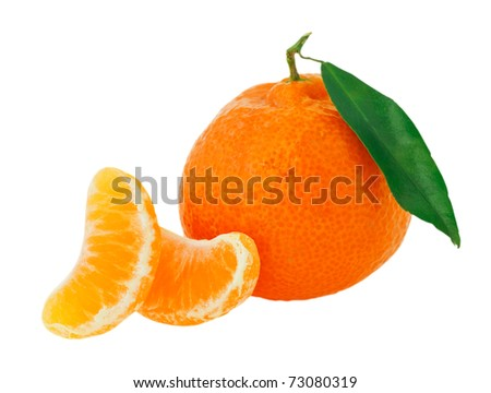 Fresh whole tangerine with some slices and green leaf isolated on white