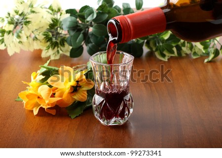 Fresh wine in crystal glass on wooden table