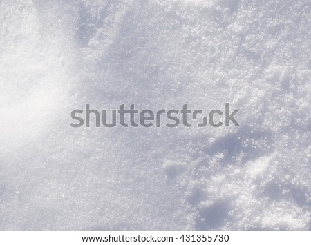 Fresh Winter Snow Texture Background - Top view texture of white fluffy snow crystals on the cold winter ground, Christmas background nature photo.