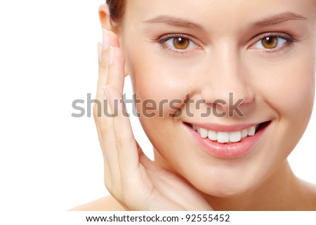 Fresh woman looking at camera over white background - stock photo