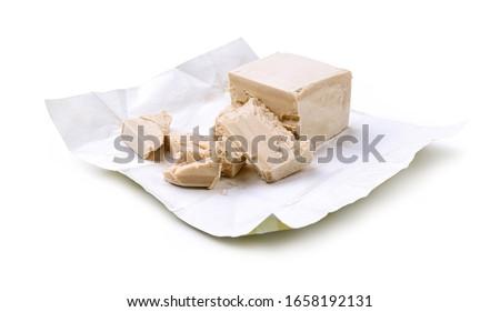 Fresh yeast cube. Fresh brewer's yeast on white background. Stock fotó ©