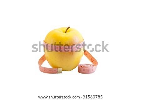 Fresh yellow apple and measuring tape isolated on white