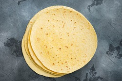 Fresh yellow corn tortilla, on gray background, top view flat lay with copy space for text