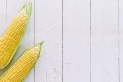 Fresh  yellow sweet corn on wooden table