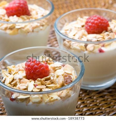 Fresh yogurt and muesli with a raspberry