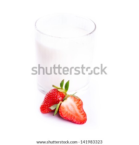 Fresh yougurt in a glass with strawberry isolated on white background