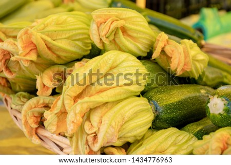 Fresh zucchini flower or courgettes in a farmer agricultural open air market, seasonal healthy food. Concept of biological, bio products, bio ecology, grown by yourself, vegetarians #1434776963