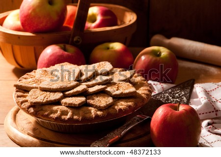 Freshly baked apple pie decorated with pastry leaves in country ...