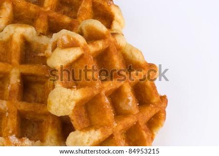 Freshly baked Belgian waffles isolated on white
