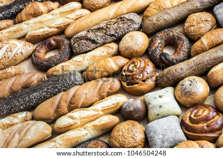 freshly baked bread and bakery products. background of bread #1046504248