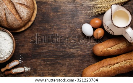 Freshly baked bread and baking ingredients. Food background concept with copyspace