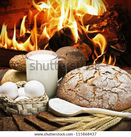 Freshly baked bread and rolls, and products for their preparation - stock photo