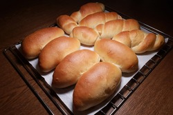 Freshly baked bread buns on baking tray